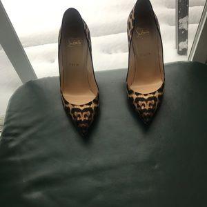 Christian Louboutin ladies leopard print heels.